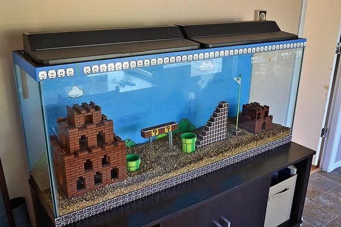 This tank uses painted lego bricks and PVC piping to recreate a scene from the iconic Super Mario Brothers video game