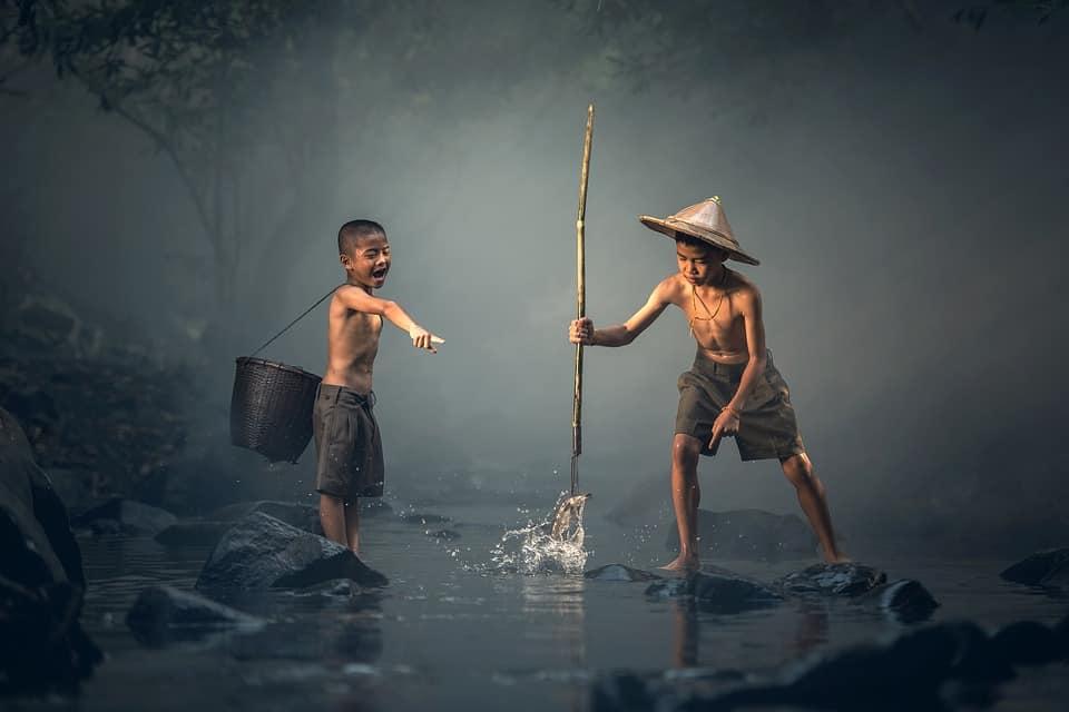 children fishing on the river