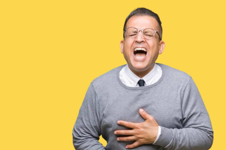 Middle age business arab man wearing glasses over isolated background Smiling and laughing hard out loud because funny crazy joke. Happy expression.